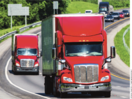 truckers on highway stock image